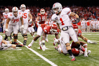 NEW ORLEANS, LA - JANUARY 04:  Dan Herron #1 of the Ohio State Buckeyes runs the ball in the second quarter against the Arkansas Razorbacks during the Allstate Sugar Bowl at the Louisiana Superdome on January 4, 2011 in New Orleans, Louisiana.  (Photo by