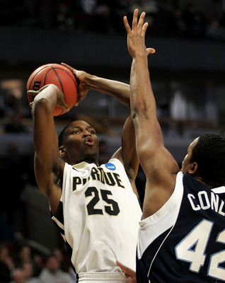 CHICAGO, IL - MARCH 18:  JaJuan Johnson #25 of the Purdue Boilermakers shoots against Darius Conley #42 of the St. Peter's Peacocks in the first half during the second round of the 2011 NCAA men's basketball tournament at the United Center on March 18, 20