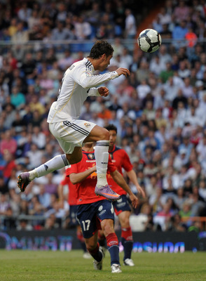 MADRID, SPAIN - MAY 02:  Cristiano Ronaldo of Real Madrid heads in his sides last minute winning goal during the La Liga match between Real Madrid and Osasuna at the Estadio Santiago Bernabeu on May 2, 2010 in Madrid, Spain. Real Madrid won the match 3-2.