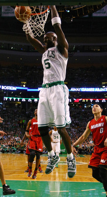 BOSTON, MA - MAY 07: Kevin Garnett #5 of the Boston Celtics dunks the ball as Mike Bibby #0 of the Miami Heat defends in Game Three of the Eastern Conference Semifinals in the 2011 NBA Playoffs on May 7, 2011 at the TD Garden in Boston, Massachusetts.  NO