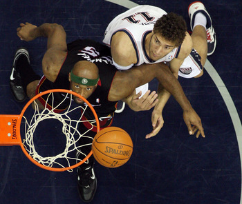NEWARK, NJ - APRIL 03:  Eric Dampier #25 of the Miami Heat and Brook Lopez #11 of the New Jersey Nets battle for rebound at the Prudential Center on April 3, 2011 in Newark, New Jersey.The Heat defeated the Nets 108-94.NOTE TO USER: User expressly acknowl