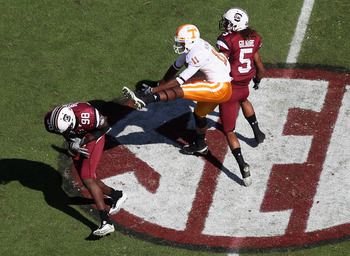 COLUMBIA, SC - OCTOBER 30:  Justin Hunter #11 of the Tennessee Volunteers watches as Devin Taylor #98 of the South Carolina Gamecocks makes an interception during their game at Williams-Brice Stadium on October 30, 2010 in Columbia, South Carolina.  (Phot