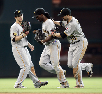 HOUSTON - JULY 17: Center fielder Andrew McCutchen #22 of the Pittsburgh Pirates is congratulated by Neil Walker #18 and Alex Pressley #44 after makeing a sliding catch on a fly ball off the bat of Clint Barmes #12 of the Houston Astros in the eighth inni