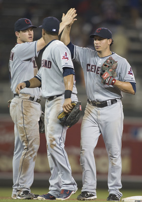 MINNEAPOLIS, MN - JULY 18: Jack Hannahan #9, Michael Brantley #23 and Asdrubal Cabrera #13 of the Cleveland Indians celebrate a win of game two in a doubleheader against the Minnesota Twins on July 18, 2011 at Target Field in Minneapolis, Minnesota. The I