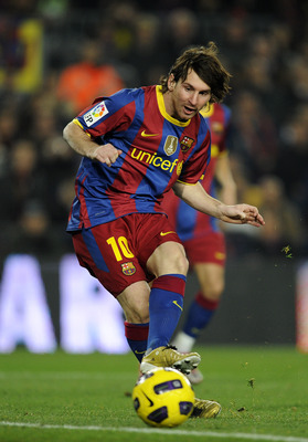 BARCELONA, SPAIN - DECEMBER 12:  Lionel Messi of Barcelona scores the third goal during the La Liga match between Barcelona and Real Sociedad at Camp Nou Stadium on December 12, 2010 in Barcelona, Spain.  Barcelona won 5-0. (Photo by David Ramos/Getty Ima