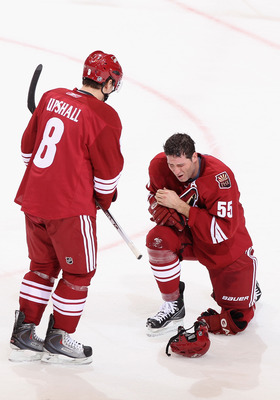 GLENDALE, AZ - FEBRUARY 14:  Ed Jovanovski #55 of the Phoenix Coyotes reacts after getting hit in the face during the NHL game against the Washington Capitals at Jobing.com Arena on February 14, 2011 in Glendale, Arizona.  The Coyotes defeated the Capital