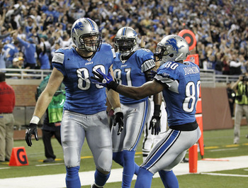 DETROIT, MI - DECEMBER 12:  Will Heller #89 of the Detroit Lions celebrates a for a fourth quarter touchdown with Bryant Johnson #80 and Calvin Johnson #81 while playing the Green Bay Packers on December 12, 2010 at Ford Field in Detroit, Michigan. Detroi