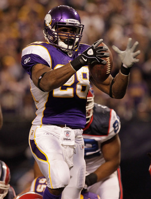 MINNEAPOLIS, MN - DECEMBER 05:  Adrian Peterson #28 of the Minnesota Vikings celebrates a touchdown against  the Buffalo Bills at the Mall of America Field at the Hubert H. Humphrey Metrodome on December 5, 2010 in Minneapolis, Minnesota.  (Photo by Nick