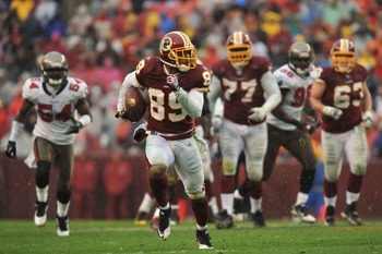 LANDOVER, MD - DECEMBER 12:  Santana Moss #89 of the Washington Redskins runs the ball against the Tampa Bay Buccaneers  at FedExField on December 12, 2010 in Landover, Maryland. The Buccaneers defeated the Redskins 17-16. (Photo by Larry French/Getty Ima