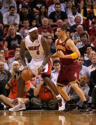 MIAMI, FL - JANUARY 31:  LeBron James #6 of the Miami Heat posts up Anthony Parker #18 of the Cleveland Cavaliers during a game at American Airlines Arena on January 31, 2011 in Miami, Florida. NOTE TO USER: User expressly acknowledges and agrees that, by