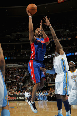 DENVER, CO - MARCH 12:  Tracy McGrady #1 of the Detroit Pistons takes a shot over Gary Forbes #0 of the Denver Nuggets at the Pepsi Center on March 12, 2011 in Denver, Colorado. NOTE TO USER: User expressly acknowledges and agrees that, by downloading and