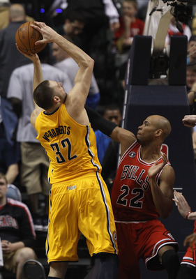 INDIANAPOLIS, IN - APRIL 23: Josh McRoberts #32 of the Indiana Pacers puts up a shot against Taj Gibson #22 of the Chicago Bulls in Game Four of the Eastern Conference Quarterfinals in the 2011 NBA Playoffs at Conseco Fieldhouse on April 23, 2011 in India