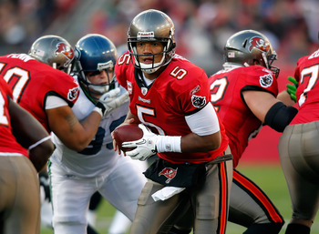 TAMPA, FL - DECEMBER 26: Quarterback Josh Freeman #5 of the Tampa Bay Buccaneers hands the ball off against the Seattle Seahawks during the game at Raymond James Stadium on December 26, 2010 in Tampa, Florida. (Photo by J. Meric/Getty Images)