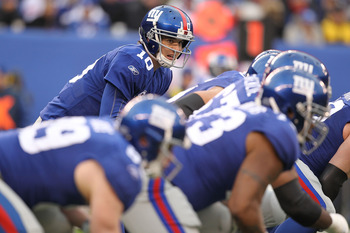 EAST RUTHERFORD, NJ - DECEMBER 19: Eli Manning #10 of the New York Giants gets ready for the snap during a game against  the Philadelphia Eagles on December 19, 2010 at The New Meadowlands Stadium in East Rutherford, New Jersey.  (Photo by Al Bello/Getty