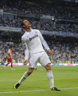 MADRID, SPAIN - MAY 21: Cristiano Ronaldo of Real Madrid celebrates after scoring his second goal during the La Liga match between Real Madrid and UD Almeria at Estadio Santiago Bernabeu on May 21, 2011 in Madrid, Spain.  (Photo by Denis Doyle/Getty Image