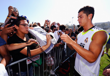LOS ANGELES, CA - AUGUST 05: Cristiano Ronaldo #9 of Real Madrid signs a soccer shirt after participating in the Adidas training with local youth soccer player August 5, 2010 in Westwood section of Los Angeles, California.   (Photo by Kevork Djansezian/Ge