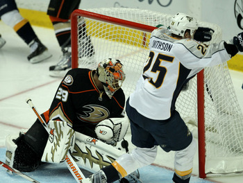 ANAHEIM - APRIL 22:  Jerred Smithson #25 of  the Nashville Predators scores the game winning goal in overtime past goalie Ray  Emery #29 of the Anaheim Ducks in Game Five of the Western Conference Quarterfinals during the 2011 NHL Stanley Cup Playoffs at