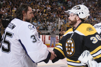 BOSTON, MA - MAY 27:  Dwayne Roloson #35 of the Tampa Bay Lightning congratulates Tim Thomas #30 of the Boston Bruins after the Bruins defeated the Lightening 1 to 0 in Game Seven of the Eastern Conference Finals during the 2011 NHL Stanley Cup Playoffs a