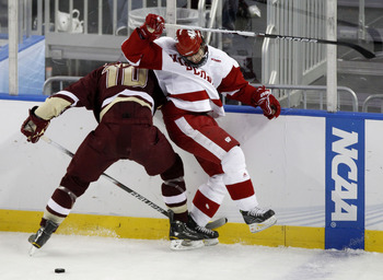 DETROIT - APRIL 10: Brendan Smith #7 of the Wisconsin Badgers tries to get to the puck around Jimmy Hayes #10 of the Boston College Eagles during the championship game of the 2010 NCAA Frozen Four on April 10, 2010 at Ford Field in Detroit, Michigan.  (Ph