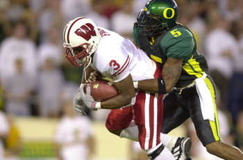01 Sep 2001: Lee Evans #3 of the Wisconsin Badgers is tackled from behind by A.K. Keyes #5 of the Oregon Ducks during the Pac-10 game at Autzen Stadium in Eugene, Orgeon.  Oregon won 31-28. DIGITAL IMAGE. Mandatory Credit: Otto Greule/Allsport