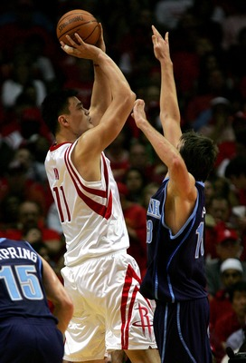 HOUSTON - APRIL 21:  Yao Ming #11 of the Houston Rockets puts up a shot against Mehmet Okur #13 of the Utah Jazz in Game One of the Western Conference Quarterfinals during the 2007 NBA Playoffs at the Toyota Center April 21, 2007 in Houston, Texas. NOTE T