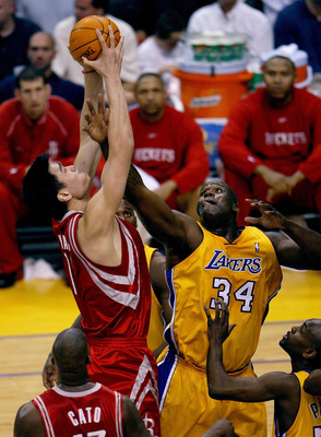 LOS ANGELES - APRIL 17:  Yao Ming #11 of the Houston Rockets goes up for a shot as Shaquille O'Neal #34 of the Los Angeles Lakers defends during Game one of the Western Conference Quarterfinals during the 2004 NBA Playoffs at Staples Center on April 17, 2