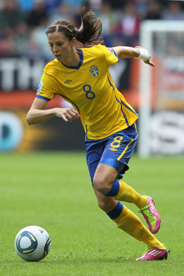 AUGSBURG, GERMANY - JULY 02: Lotta Schelin of Sweden runs with the ball during the FIFA Women's World Cup 2011 Group C match between North Korea and Sweden at FIFA World Cup stadium Augsburg on July 2, 2011 in Augsburg, Germany. (Photo by Christof Koepsel