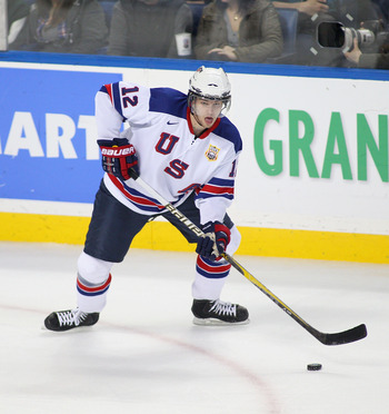 BUFFALO, NY - DECEMBER 30:  Jon Merrill #12 of the United States skates against Germany during the 2011 IIHF World U20 Championship game between United States and Germany on December 30, 2010 in Buffalo, New York. The USA won 4-0.  (Photo by Rick Stewart/