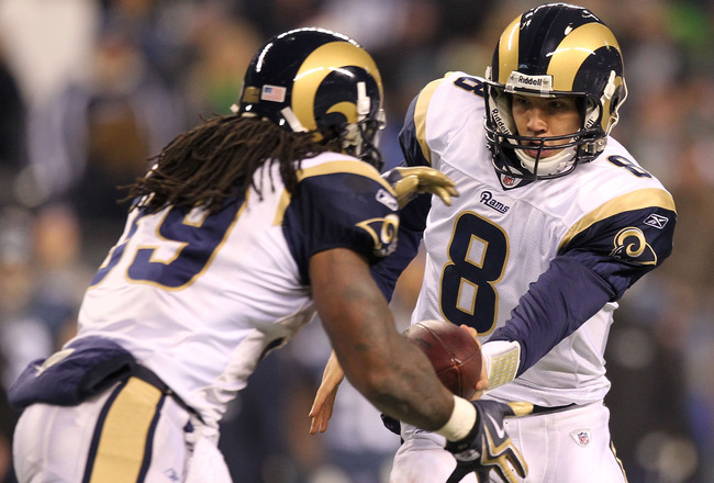 SEATTLE, WA - JANUARY 02:  Quarterback Sam Bradford #8 of the St. Louis Rams hands the ball off to running back Steven Jackson #39 during their game against the Seattle Seahawks at Qwest Field on January 2, 2011 in Seattle, Washington.  (Photo by Otto Gre