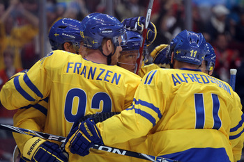 VANCOUVER, BC - FEBRUARY 21:  Johan Franzen #93 and Daniel Alfredsson #11 of Sweden celebrate after Loui Eriksson scored a goal against Finald during the ice hockey men's preliminary game on day 10 of the Vancouver 2010 Winter Olympics at Canada Hockey Pl