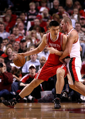 PORTLAND, OR - APRIL 18:  Yao Ming #11 of the Houston Rockets drives against Joel Przybilla #10 of the Portland Trail Blazers during Game One of the Western Conference Quarterfinals of the 2009 NBA Playoffs on April 18, 2009 at the Rose Garden in Portland