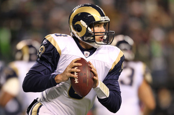 SEATTLE, WA - JANUARY 02:  Quarterback Sam Bradford #8 of the St. Louis Rams looks to pass against the Seattle Seahawks during their game at Qwest Field on January 2, 2011 in Seattle, Washington.  (Photo by Otto Greule Jr/Getty Images)
