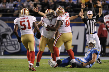 SAN DIEGO, CA - DECEMBER 16:  Defensive tackle Isaac Sopoaga #90 of the San Francisco 49ers celebrates with teammates after sacking quarterback Philip Rivers #17 of the San Diego Chargers at Qualcomm Stadium on December 16, 2010 in San Diego, California.