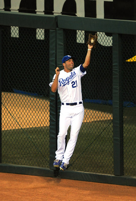 KANSAS CITY, MO - JUNE 21:  Jeff Francoeur #21 of the Kansas City Royals makes a catch against the wall on a ball hit by Kelly Johnson of the Arizona Diamondbacks in the seventh inning at Kauffman Stadium on June 21, 2011 in Kansas City, Missouri. (Photo