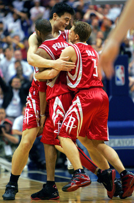 DALLAS - APRIL 25:  Tracy McGrady #1 of the Houston Rockets celebrates with Yao Ming #11 and Bob Sura #3 after scoring the final two-points against the Dallas Mavericks in Game two of the Western Conference Quarterfinals during the 2005 NBA Playoffs on Ap