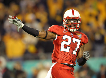 ORLANDO, FL - DECEMBER 28: Earl Wolff #27 of the North Carolina State Wolfpack celebrates after a fumble recovery during the Champs Sports Bowl against the West Virginia Mountineers at Florida Citrus Bowl Stadium on December 28, 2010 in Orlando, Florida.