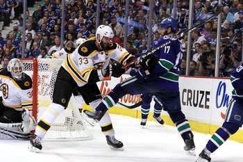 VANCOUVER, BC - JUNE 01:  Zdeno Chara #33 of the Boston Bruins draws contact from Ryan Kesler #17 of the Vancouver Canucks during game one of the 2011 NHL Stanley Cup Finals at Rogers Arena on June 1, 2011 in Vancouver, Canada.  (Photo by Bruce Bennett/Ge