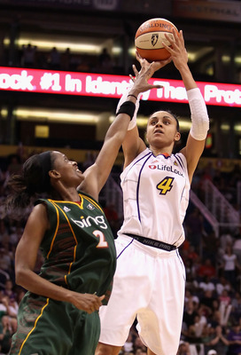 PHOENIX - SEPTEMBER 05:  Candice Dupree #4 of the Phoenix Mercury puts up a shot over Swin Cash #2 of the Seattle Storm in Game Two of the Western Conference Finals during the 2010 WNBA Playoffs at US Airways Center on September 5, 2010 in Phoenix, Arizon