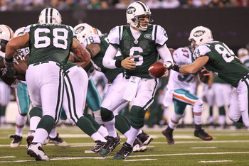EAST RUTHERFORD, NJ - DECEMBER 12:  Mark Sanchez #6 of the New York Jets looks to hand the ball off against the Miami Dolphins at New Meadowlands Stadium on December 12, 2010 in East Rutherford, New Jersey.  (Photo by Nick Laham/Getty Images)