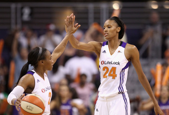 PHOENIX, AZ - JULY 05:  DeWanna Bonner #24 of the Phoenix Mercury high fives Temeka Johnson #2 during the WNBA game against the Los Angeles Sparks at US Airways Center on July 5, 2011 in Phoenix, Arizona.  The Mercury defeated the Sparks 101-82.  NOTE TO