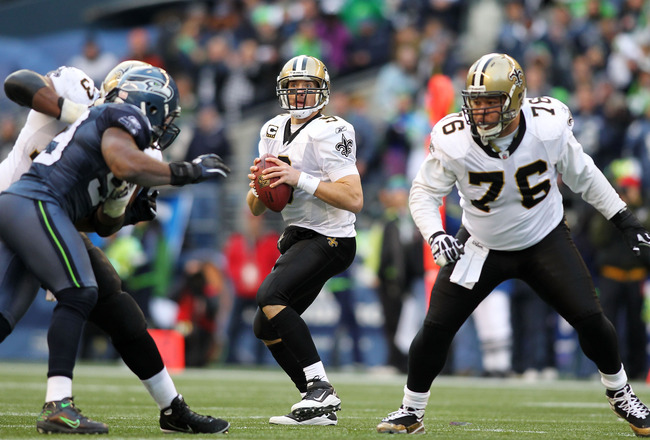SEATTLE, WA - JANUARY 08:  Drew Brees #9 of the New Orleans Saints scrambles against the Seattle Seahawks during the 2011 NFC wild-card playoff game at Qwest Field on January 8, 2011 in Seattle, Washington.  (Photo by Jonathan Ferrey/Getty Images)