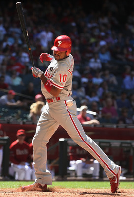 PHOENIX, AZ - APRIL 27:  Ben Francisco #10 of the Philadelphia Phillies is hit by a pitch from the Arizona Diamondbacks during the seventh inning of the Major League Baseball game at Chase Field on April 27, 2011 in Phoenix, Arizona.  The Phillies defeate