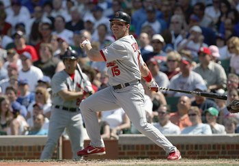 CHICAGO - APRIL 22: Jim Edmonds #15 of the St. Louis Cardinals swings at the pitch against the Chicago Cubs on April 22, 2007 at Wrigley Field in Chicago, Illinois. (Photo by Jonathan Daniel/Getty Images)