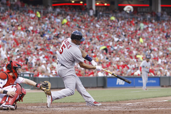 CINCINNATI, OH - JULY 16: Albert Pujols #5 of the St. Louis Cardinals hits a three-run home run in the fifth inning against the Cincinnati Reds at Great American Ball Park on July 16, 2011 in Cincinnati, Ohio. (Photo by Joe Robbins/Getty Images)