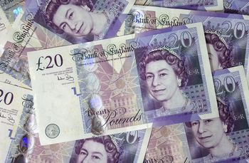 Several-pound-bills-new-british-20-pounds-money_display_image