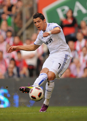 BILBAO, SPAIN - APRIL 09:  Cristiano Ronaldo of Real Madrid scores Real's third goal during the La Liga match between Athletic Bilbao and Real Madrid at San Mames Stadium on April 9, 2011 in Bilbao, Spain.  (Photo by Denis Doyle/Getty Images)