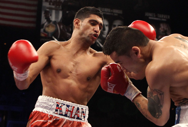LAS VEGAS - DECEMBER 11:  (L-R) Amir Khan of England throws a left to the face of Marcos Maidana of Argentina during the WBA super lightweight title fight at Mandalay Bay Events Center on December 11, 2010 in Las Vegas, Nevada.  (Photo by Scott Heavey/Get