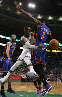 BOSTON, MA - APRIL 19:  Rajon Rondo #9 of the Boston Celtics passes the ball around Amare Stoudemire #1 of the New York Knicks in Game Two of the Eastern Conference Quarterfinals in the 2011 NBA Playoffs on April 19, 2011 at the TD Garden in Boston, Massa