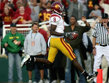 PASADENA, CA - JANUARY 01:  Dwayne Jarrett #8 of the USC Trojans carries the ball for a 22 yard touchdown against the Michigan Wolverines during the third quarter of the Rose Bowl game on January 1, 2007 at the Rose Bowl in Pasadena, California. The Troja