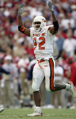 DALLAS - JANUARY 2:  Wide receiver Rashaun Woods #82 of the Oklahoma State Cowboys celebrates during the SBC Cotton Bowl against the Mississippi Rebels  on January 2, 2004 at the Cotton Bowl in Dallas, Texas.  'Ole Miss defeated Oklahoma State 31-28.  (Ph